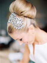 Statement high bun and hair accessory {via dustjacketattic.tumblr.com}