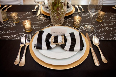 Black, gold and white table setting idea {via weddingobsession.com}