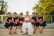 Bridesmaids in navy and coral {via brideside.com}