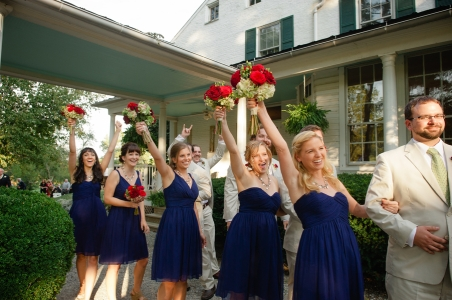 Bridesmaids in navy with red bouquets {via unitedwithlove.com}
