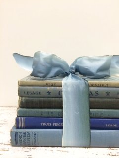 Books as centrepieces - www.etsy.com/shop/beachbabyblues