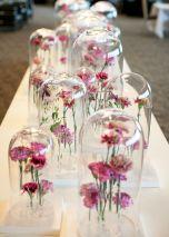 Great centrepiece idea - flowers under glass domes {via blog.accentdecor.com}