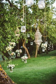 Hang votive candles and vases from the trees {via magnoliarouge.com}