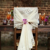 Lace material as chair decor {via intimateweddings.com}