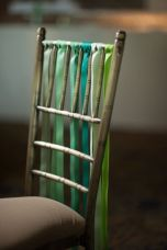 Ribbons on the backs of chairs {via stylemepretty.com}