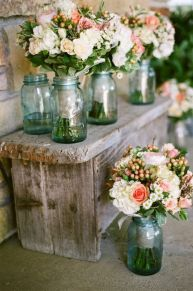 Use mason jars to display your bridesmaids' bouquets {via tidbitsandtwine.com}