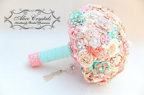 Available from https://www.etsy.com/nz/listing/193963373/brooch-bouquet-ivory-and-champagne-mint?ga_order=most_relevant&ga_search_type=all&ga_view_type=gallery&ga_search_query=gold%2C+mint+and+pink+wedding&ref=sr_gallery-2-31&organic_search_click=1