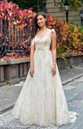 White and gold wedding dress, available from https://www.etsy.com/nz/listing/660231853/gold-wedding-dress-wedding-dress-lace?ga_order=most_relevant&ga_search_type=all&ga_view_type=gallery&ga_search_query=gold+wedding+dress&ref=sr_gallery-1-22&organic_search_click=1&frs=1