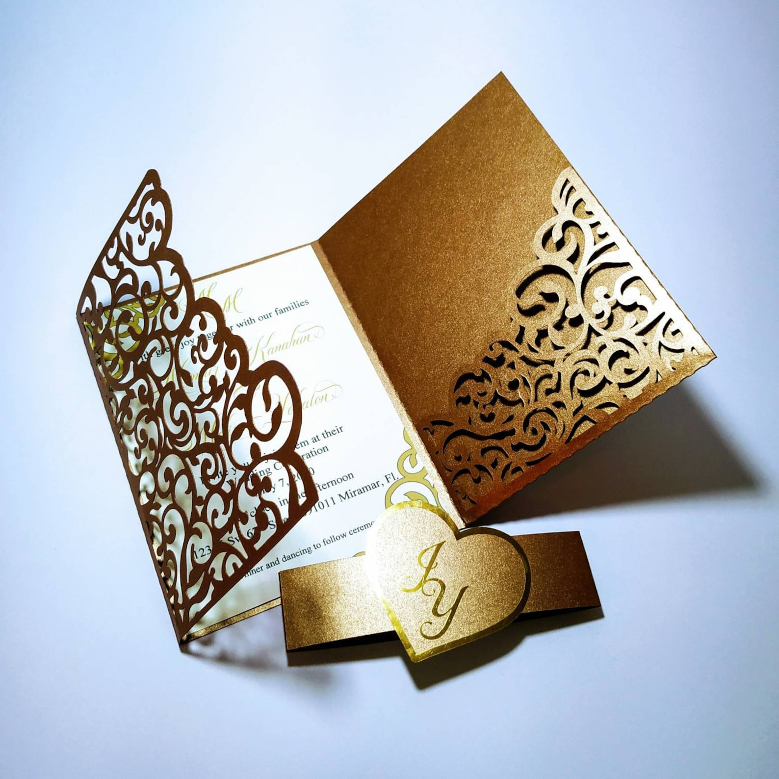 Gold and white laser-cut wedding invitation